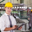 Modern textile factory manager using tablet computer - Stock Photo