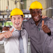 Factory manager and worker thumbs up — 图库照片