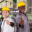 Foto Stock: Happy factory foreman and worker thumbs up