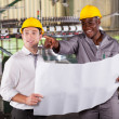Factory manager and worker discussing about production plan — Stockfoto