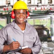 Handsome african american blue collar worker portrait inside factory — Stock Photo