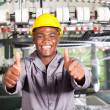African american textile worker thumbs up in front of weaving loom — Stock Photo #14967909