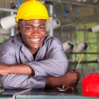 Stock Photo: Happy africamericfactory technicirepairing loom