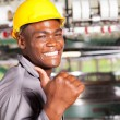 Happy african american textile worker thumb up in factory — Stock Photo #14967963