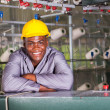 Smiling african american textile factory worker portrait — Stock Photo