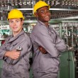 Two textile industrial technicians portrait in factory — Foto de Stock