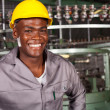 African american industrial worker portrait in front of machine — Stock Photo