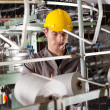 Textile industrial worker working in factory — Stock Photo