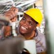 African american textile industrial quality controller at work — Stock Photo