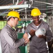 Two textile workers disscussing work in factory — Stockfoto