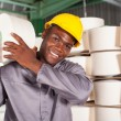 Textile factory worker carrying raw material on his shoulder — Stock Photo