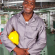 Stock Photo: African american blue collar industrial worker in factory