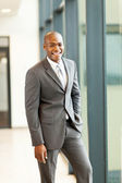 Handsome young african american businessman in office — Stock Photo