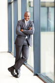 Young african american businessman full length portrait in office — Stock Photo