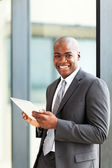 Happy african american entrepreneur using tablet computer — Stock Photo