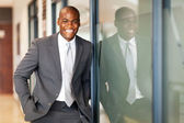 Happy african american business executive portrait in office — Stock Photo