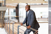 African american businessman in modern office building — Stock Photo
