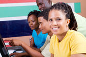 Group of adult african students in classroom — Stock Photo