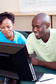 Two adult african students studying computer together — Stock Photo