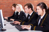 Group of high school students using computers in classroom — Stock Photo