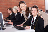 High school teacher and students in computer room — Stock Photo
