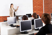 High school teacher teaching in classroom — Stock Photo