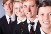 Group of high school students in uniforms closeup portrait — Stock Photo