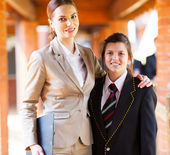 Female high school teacher and student portrait — Stok fotoğraf