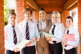 High school teacher and students portrait — Stockfoto