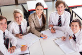 Overhead view of high school teacher and students in classroom — Stock Photo