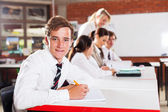 Male teenage high school student in classroom — Stock Photo
