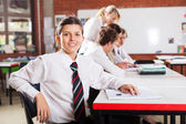 Cute female high school student in classroom — Stock Photo