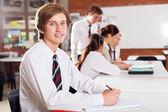 High school boy portrait in classroom — Stock Photo