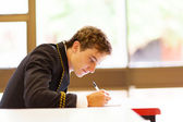 Male high school student in classroom — Stock fotografie