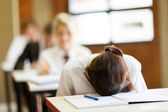 Frustrated high school student in classroom — Stok fotoğraf