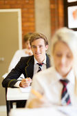 Group of high school students in classroom — Stock Photo