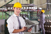 Modern textile factory manager using tablet computer — Stock Photo