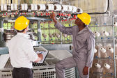 Textile factory manager and worker checking yarn on weaving machine — Stok fotoğraf