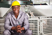 Happy african american textile factory worker portrait — Stock Photo