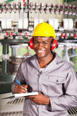 Happy african textile factory worker portrait in front of weaving machine — Stock Photo