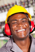 Happy african american factory worker closeup portrait — Stock Photo
