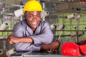 Happy african american factory technician repairing loom — Stock Photo