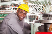 Happy african american textile factory worker — Stock Photo