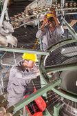 Two textile weaving machine mechanics fixing loom — Stock Photo
