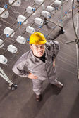 Textile factory worker looking up — Stock Photo