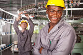 African american textile worker portrait in factory — Stock Photo