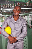 African american blue collar industrial worker in factory — Stock Photo