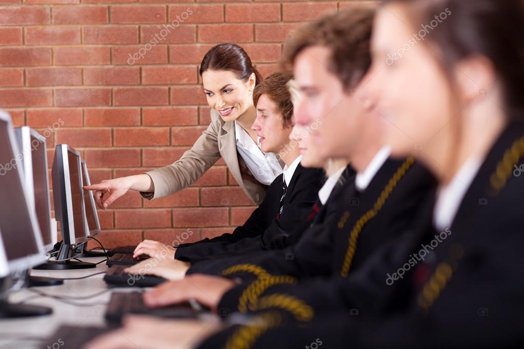 High school students and teacher in computer room  Stock Photo #14966393
