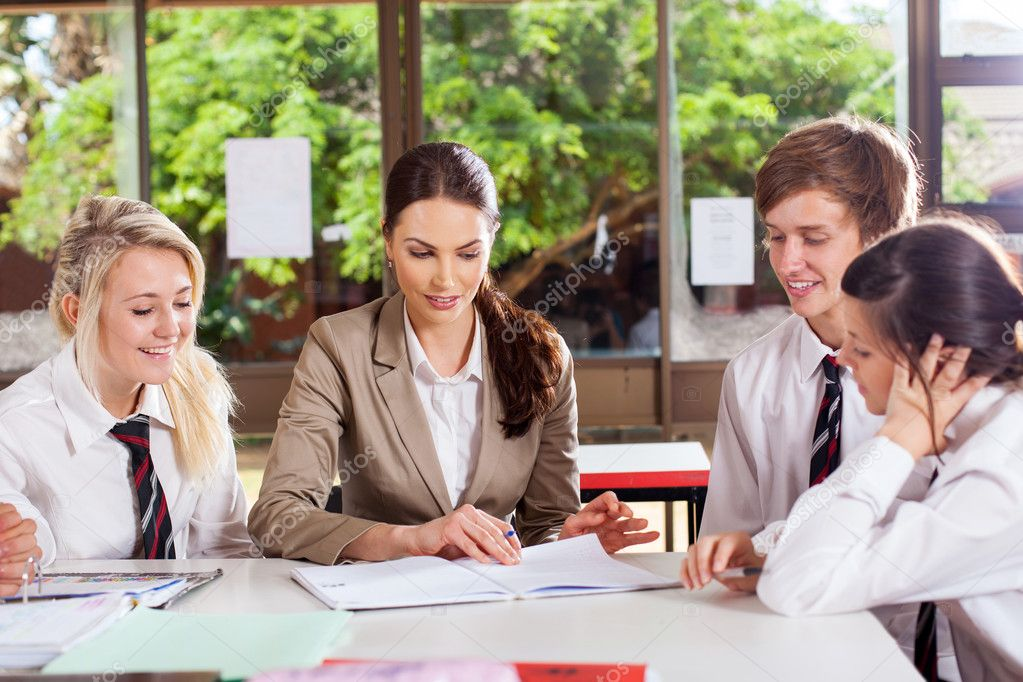 High school teacher helping students in classroom — Stock Photo #14967019