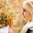Young pretty woman in autumn forest — Stock Photo